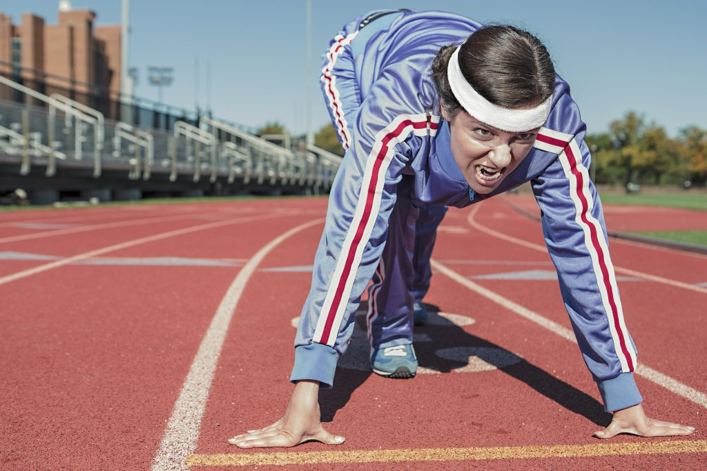 Woman positioned at starting line ready to race